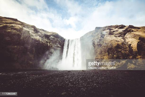 scenic view of waterfall against sky - cuomo stock pictures, royalty-free photos & images