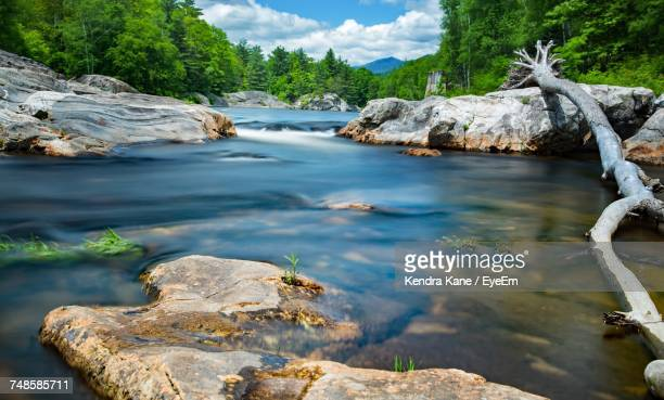 scenic view of waterfall against sky - manchester new hampshire stock pictures, royalty-free photos & images
