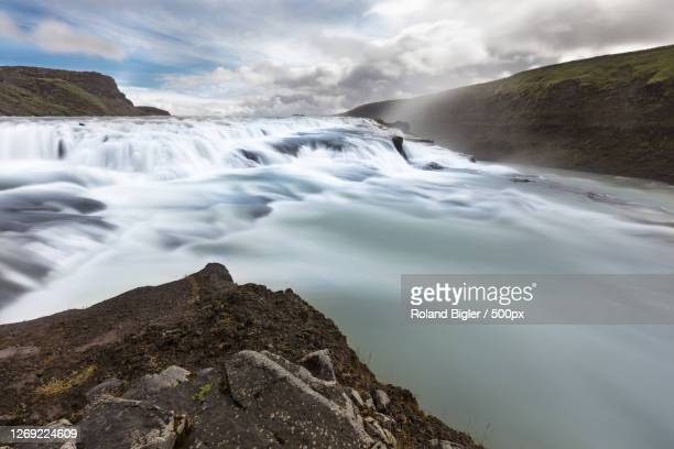 scenic view of waterfall against sky, selfoss, iceland - wasser stock pictures, royalty-free photos & images