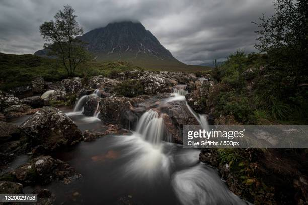scenic view of waterfall against sky,ballachulish,united kingdom,uk - grampian scotland stock pictures, royalty-free photos & images