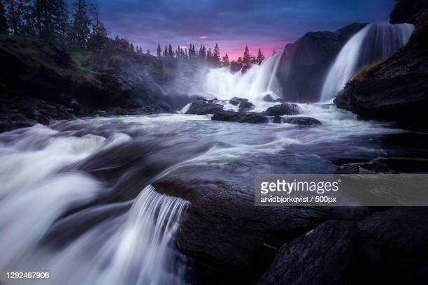 scenic view of waterfall against sky,sverige,sweden - sweden stock pictures, royalty-free photos & images
