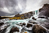 Scenic view of waterfall and river in Iceland