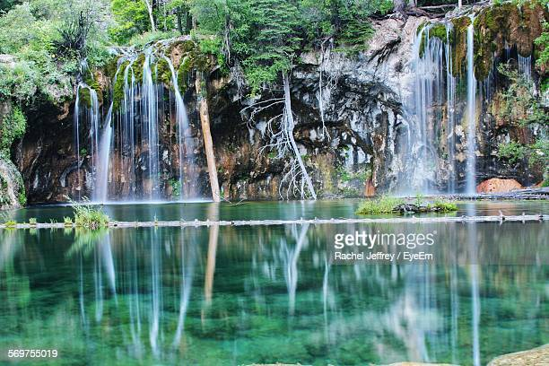 Scenic View Of Waterfall At Hanging Lake