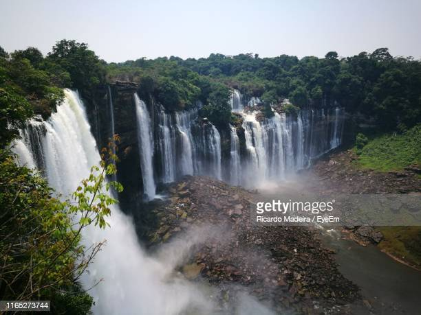 scenic view of waterfall in forest against clear sky - angola stock pictures, royalty-free photos & images