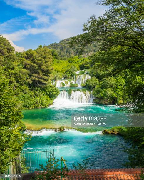 scenic view of waterfall in forest against sky - dalmatia region croatia stock pictures, royalty-free photos & images