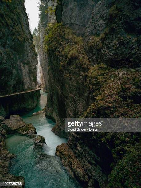 scenic view of waterfall in forest - inside out of  leutaschklamm, scenic view of a gorge - mittenwald fotografías e imágenes de stock