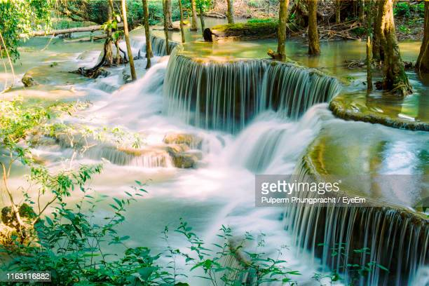scenic view of waterfall in forest - カンチャナブリ県 ストックフォトと画像