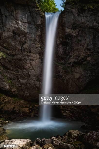 scenic view of waterfall in forest,leuenfall,schwende,switzerland - wasser imagens e fotografias de stock