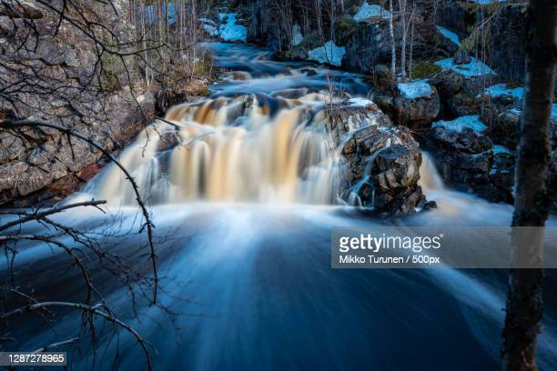 scenic view of waterfall in forest,suomussalmi,finland - finland stock pictures, royalty-free photos & images