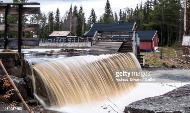 scenic view of waterfall in winter - eriksen stock pictures, royalty-free photos & images