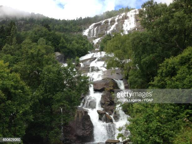 scenic view of waterfall - lagarde stock photos and pictures