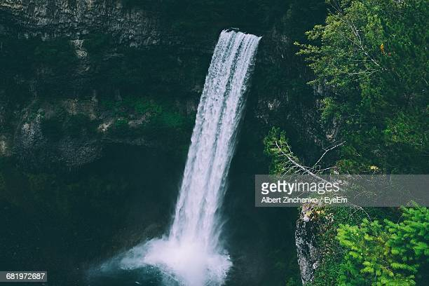 scenic view of waterfall - zinchenko stock pictures, royalty-free photos & images