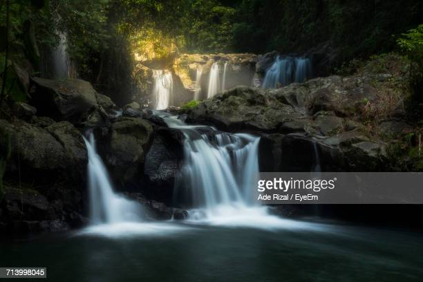 scenic view of waterfall - ade rizal stock photos and pictures