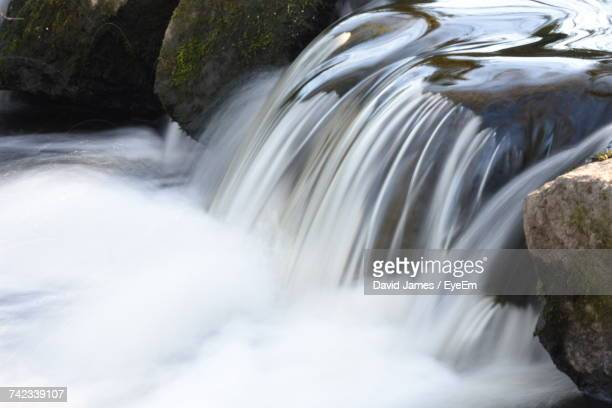 scenic view of waterfall - flowing stock pictures, royalty-free photos & images