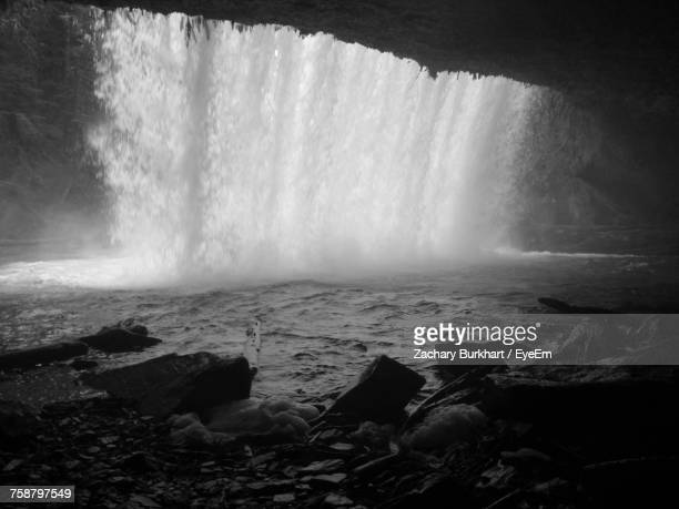scenic view of waterfall - behind waterfall stock pictures, royalty-free photos & images