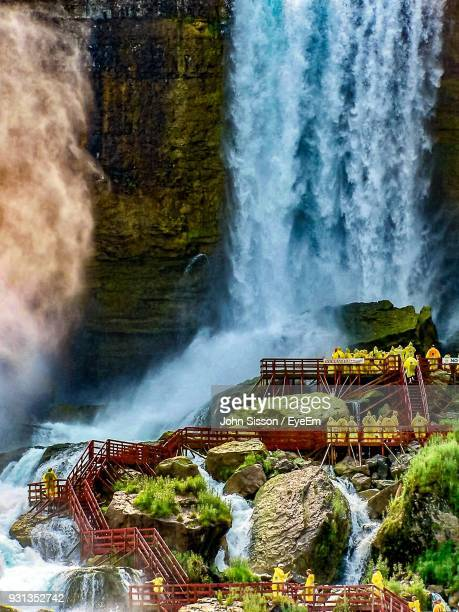 scenic view of waterfall - niagara falls photos stock photos and pictures