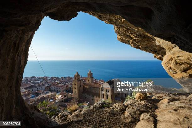Scenic view of waterfront cityscape from cave