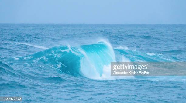 scenic view of waves in sea - image title stock pictures, royalty-free photos & images