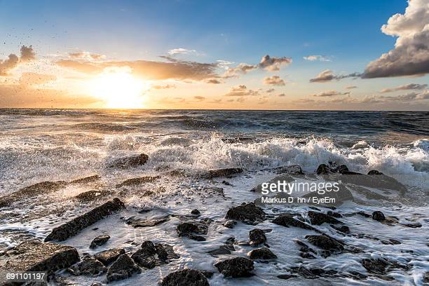 Scenic View Of Wavy Sea At Sunset