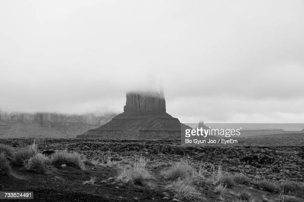 Scenic View Of West And East Mitten Buttes During Foggy Weather