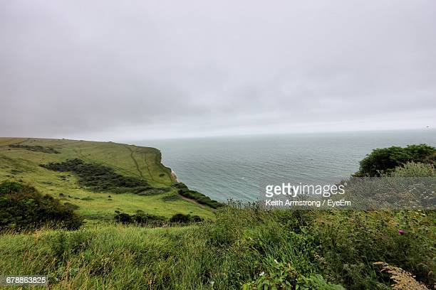 Scenic View Of White Cliffs Of Dover And Sea Against Sky