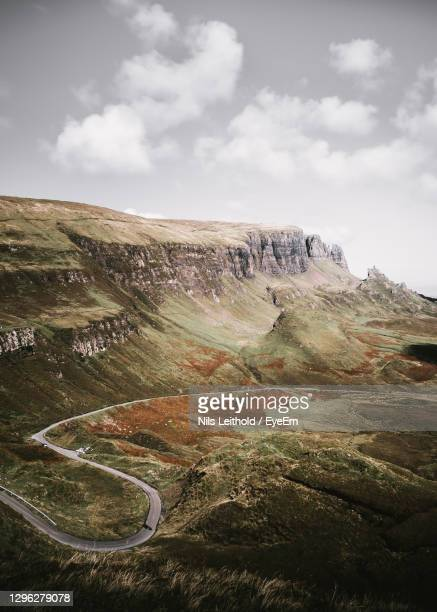 scenic view of winding road against sky - overhead view stock pictures, royalty-free photos & images