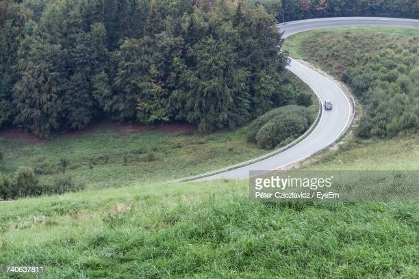 Scenic View Of Winding Road Amidst Trees