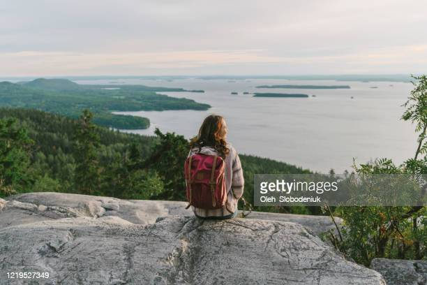 scenic  view of woman looking at  lake in finland - finland stock pictures, royalty-free photos & images