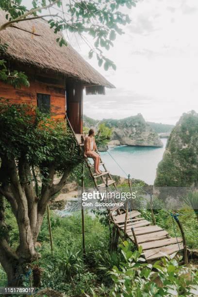 Scenic view of woman near the  tree house near the sea on Nusa Penida