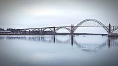 Scenic View Of Yaquina Bay Bridge Over Water Against Sky