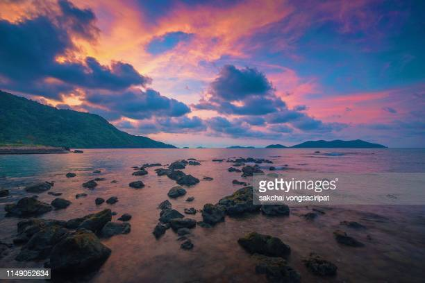 scenic view on beach against sky during sunrise at koh chang island, thailand - インド洋 ストックフォトと画像