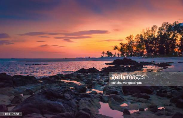 scenic view on the beach against sky during sunrise at koh lipe island in thailand - インド洋 ストックフォトと画像