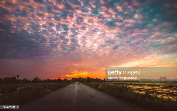 Scenic View On The Road Against Dramatic Sky During Sunrise
