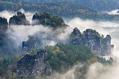 Scenic view over Bastei hiking area in Saechsische Schweiz with sandstone crags and pillars, taken in late October, Saxon Switzerland National Park, Saxony, Germany, Europe.