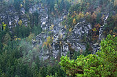 Scenic view over Bastei hiking area in Saechsische Schweiz with sandstone pillars and crags, taken in late October,  Saxon Switzerland National Park, Saxony, Germany, Europe.
