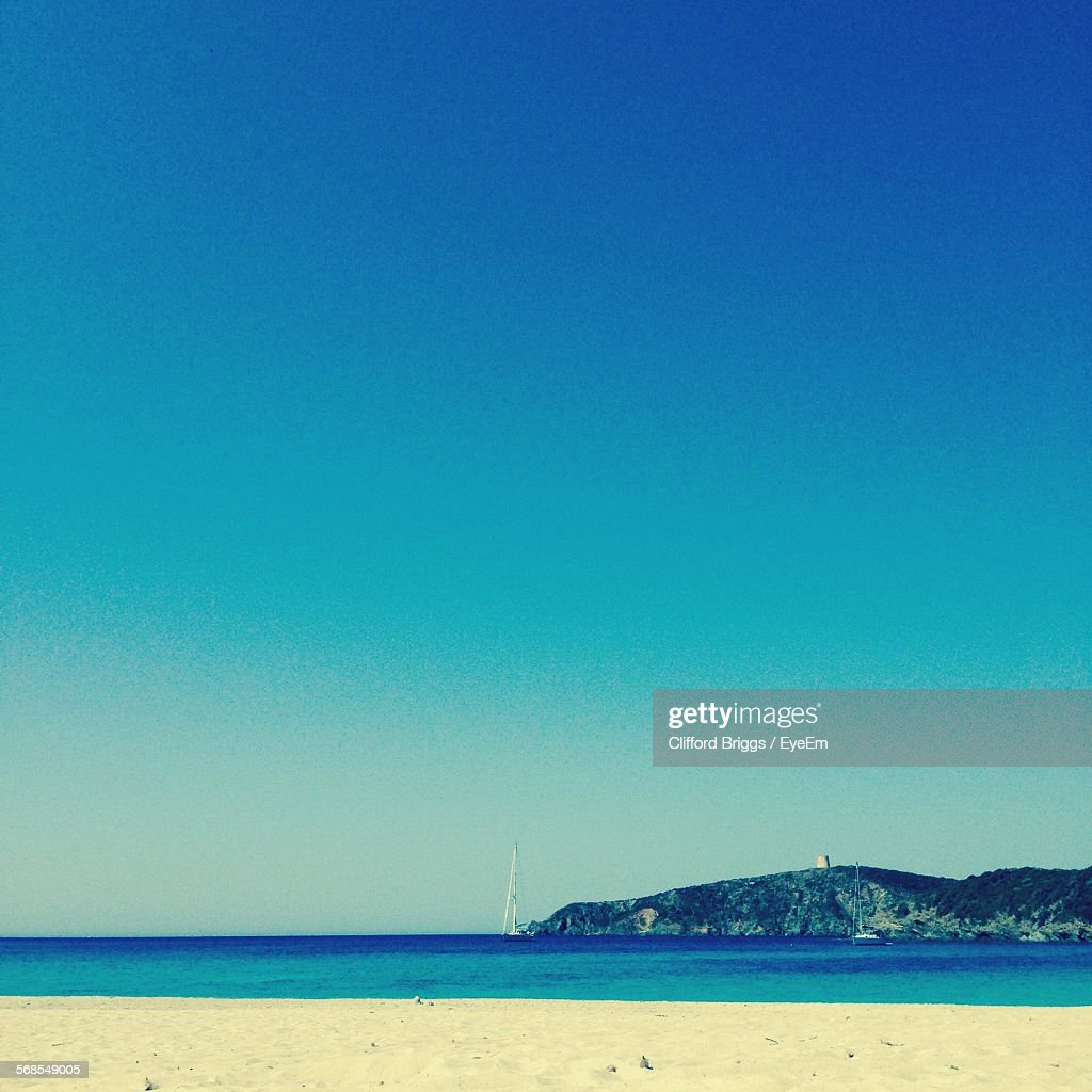 Scenic View Sea Against Clear Blue Sky : Stock Photo