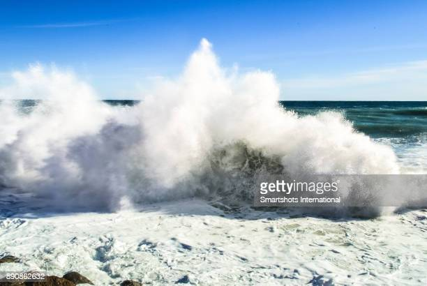 Scenic wave breaking at high tide in the Mediterranean sea near Genoa, Liguria, Italy