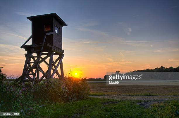 scenic with hunters blind in very last evening light - hut stock pictures, royalty-free photos & images