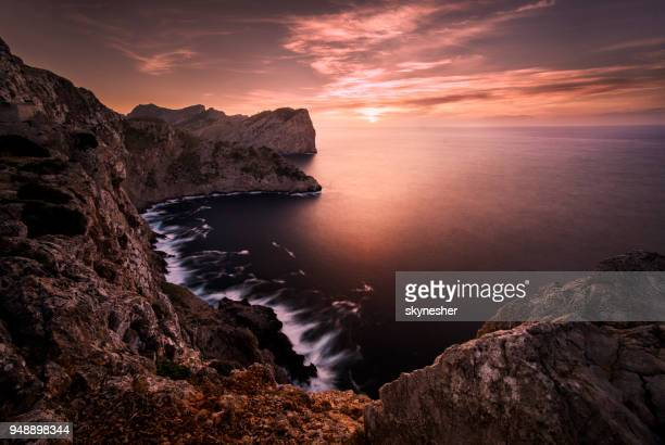 scenics cliffs and coastline of mallorca at sunset. - paesaggio spettacolare foto e immagini stock