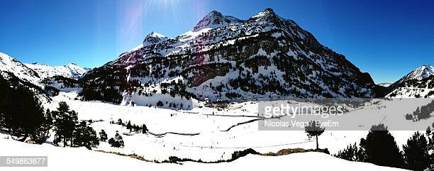 Scenics Shot Of Snow Covered Mountain And Ski Resorts