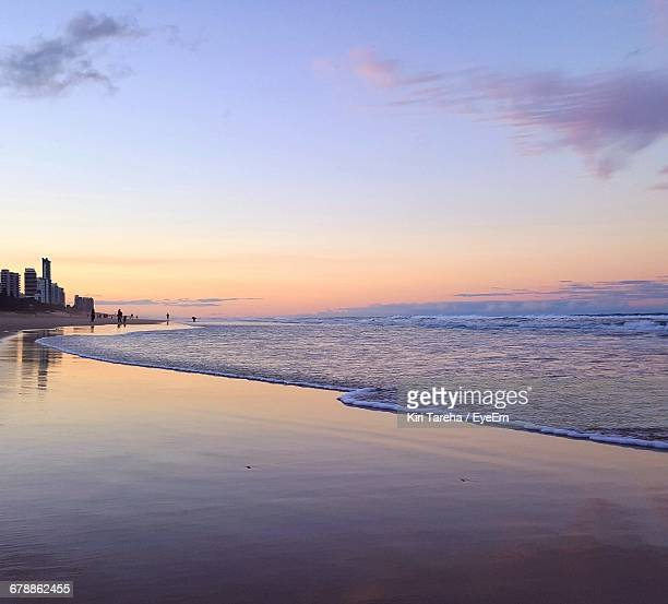 Scenics View Of Beach At Dusk