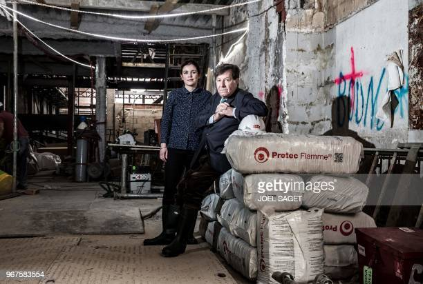 Scenographer painter and designer Richard Peduzzi and his assistant Laure Montagne pose for a photograph on May 16 2018 at the worksite of La...