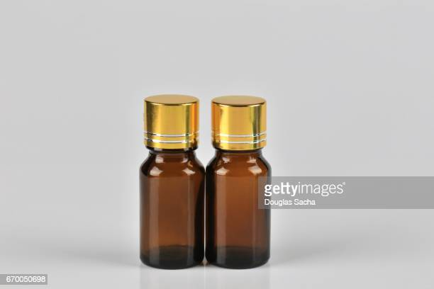 scented perfume and fragrance bottles - tea tree oil stock photos and pictures