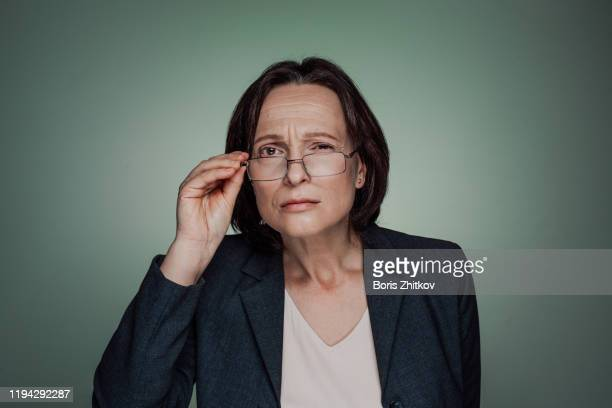 sceptic businesswoman - suspicion stock pictures, royalty-free photos & images
