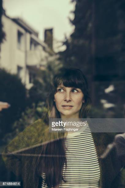 Sceptical woman looking out of window