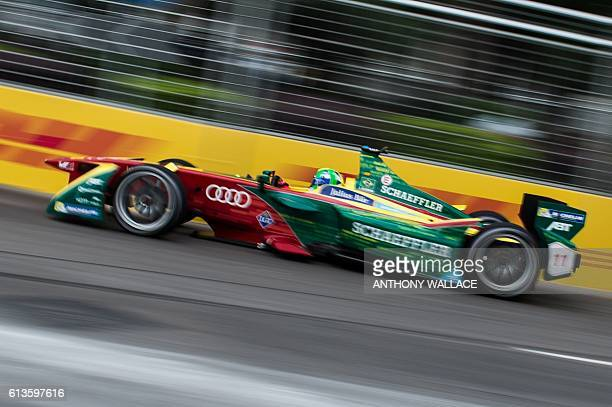 ABT Schaeffler Audi Sport driver Lucas di Grassi of Brazil takes a corner during the Formula E championship in Hong Kong on October 9 2016 / AFP /...