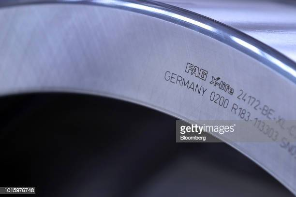 A Schaeffler Fag Xlife spherical roller bearing sits on the assembly line inside the Schaeffler AG factory in Schweinfurt Germany on Tuesday July 3...