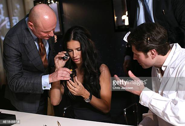 Schaffhausen CEO George Kern and Adriana Lima visit the IWC booth during the Salon International de la Haute Horlogerie 2015 at the Palexpo on...