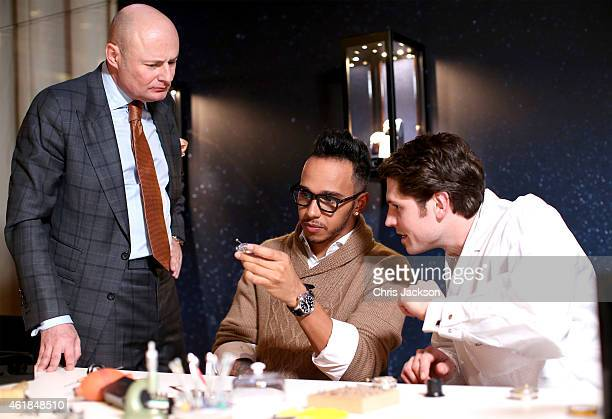 Schaffhausen CEO George Kern and Lewis Hamilton visit the IWC booth during the Salon International de la Haute Horlogerie 2015 at the Palexpo on...