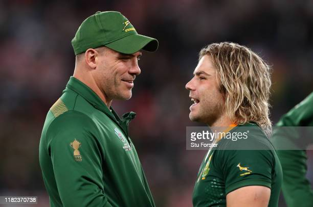 Schalk Brits and Faf De Klerk of South Africa share a joke after the Rugby World Cup 2019 Quarter Final match between Japan and South Africa at the...